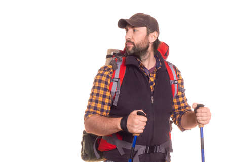 Handsome middle aged traveler with backpack looking by side - isolated on white. Standard-Bild