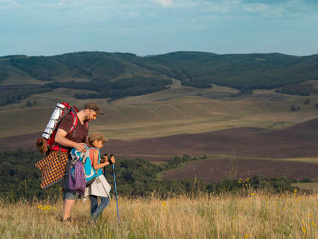 Father and daughter travel in nature - looking at view. Standard-Bild - 150328047
