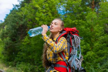 Close up photo of a female hiker in the forest. Standard-Bild