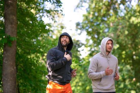 Two men jogging outdoor. Selective focus. Standard-Bild