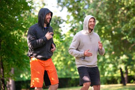 Two men jogging outdoor. Morning running.