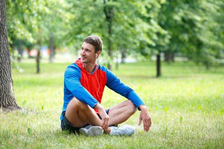 Man having rest after workout outdoor. Standard-Bild - 150771585