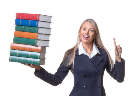 Smiley businesswoman or lawer holding a stack of books and showing attention sign by finger on white background