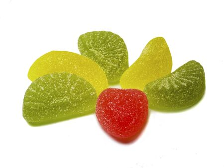 goodie: close-up red green and yellow sweets isolated on white Stock Photo