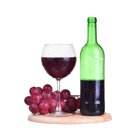 spirituous beverages: Bottle, red wine in glass with grapes isolated on white background Stock Photo