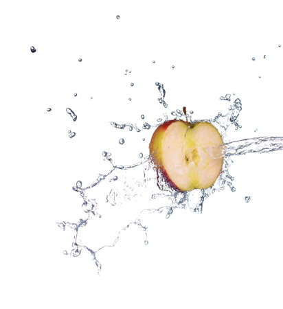Green apple with water splash in spray of water