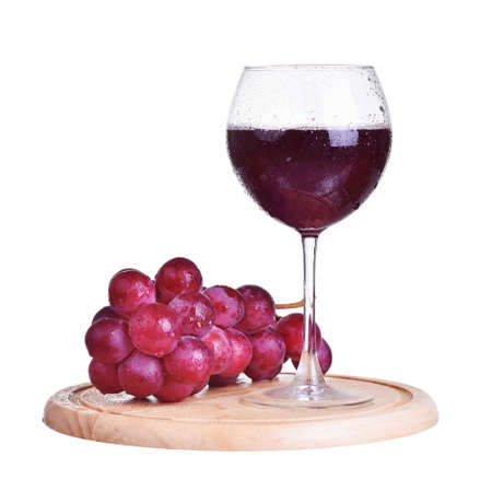 Glass of red wine and grapes, isolated on white