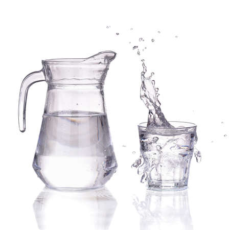 Fresh water glass with splash and bottle isolated on a white background Stok Fotoğraf