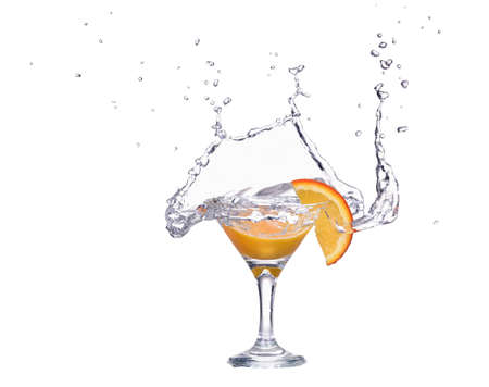 Orange or lemon slice fall in glass with water and make splash