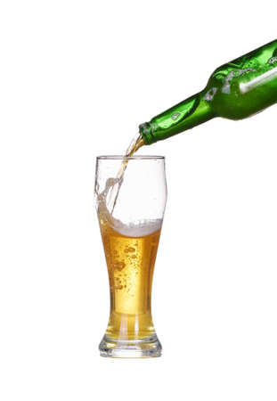 Isolated Beer is poured into a glass Foto de archivo