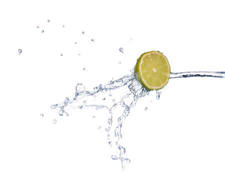 lime in spray of water. lime cucumber with splash on background Stok Fotoğraf