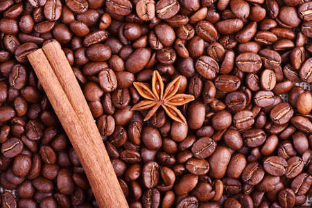 Brown coffee, cinnamon and star anise on the table