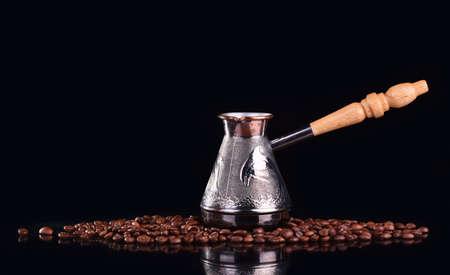 Turk and coffee beans on dark background Standard-Bild