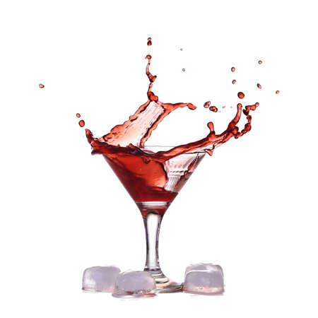 Red wine make splash into glass near ice cubes isolated on white Standard-Bild