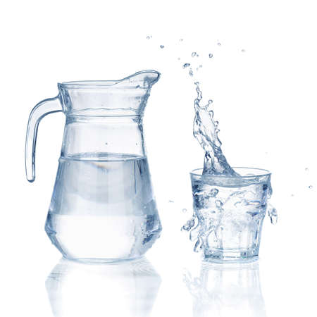 Fresh water glass with splash and bottle isolated on a white background Standard-Bild