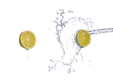 lime in spray of water. lime cucumber with splash on background Stockfoto