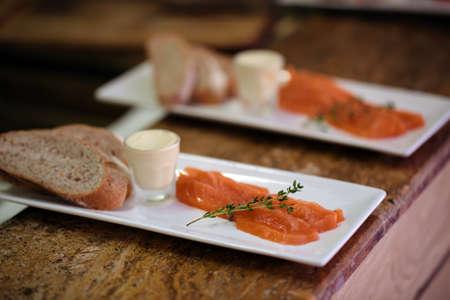 Salmon on white plate in restaurant