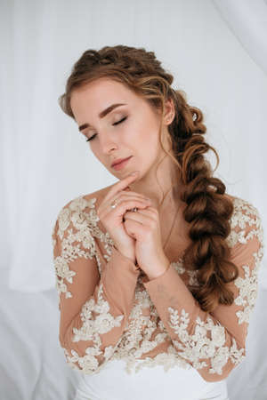 Classical young gourgeous bride. Studio interior fashion shot of fashion model in wedding dress with profeshional make-up and hair