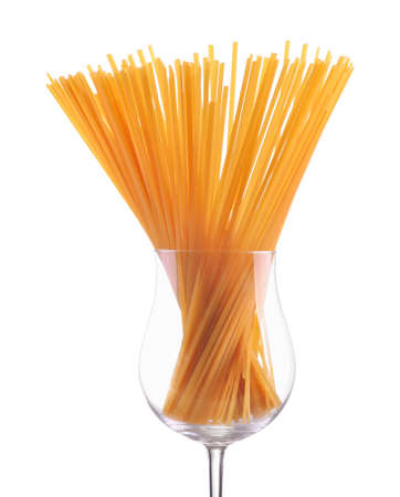 closeup pasta spaghetti noodles in glass isolated on white background Standard-Bild