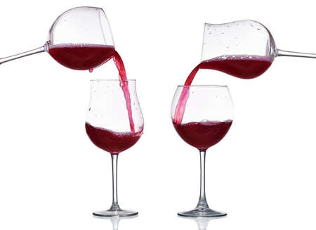 Red wine pouring from glass to glass