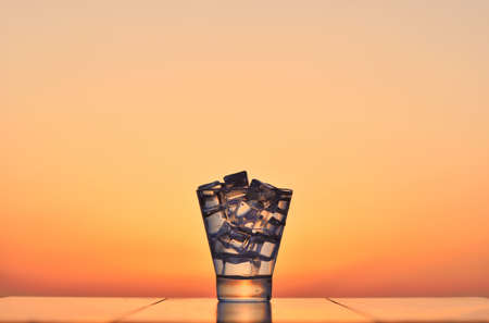 Cocktail with ice at sunset