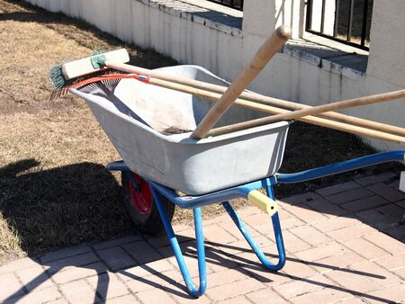 cart with tools for spring cleaning