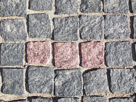 the texture is a square granite stone pavement