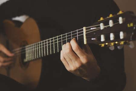 Man playing classic guitar. Close up