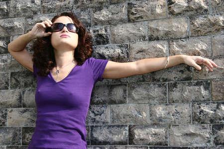 sunshades: Young girl with sunshades at the wall