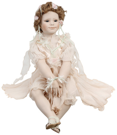 Porcelain doll with pink dress. Isolated on a white background Stock Photo