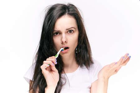 Woman brushes teeth on isolated background portrait. 版權商用圖片 - 80235209