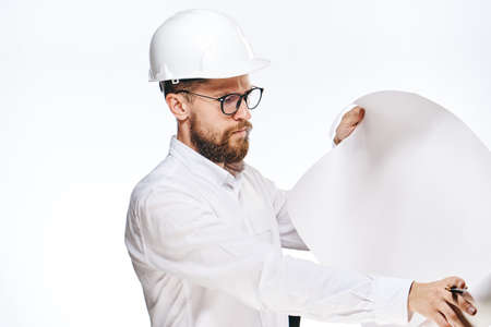 Businessman working, businessman in hard hat, businessman looking at drawing on isolated background.