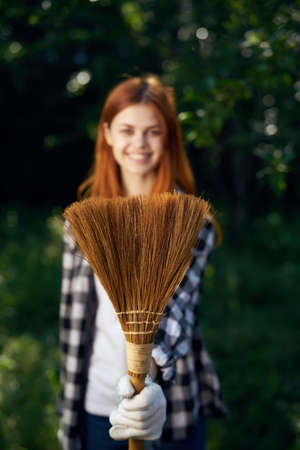 pitchfork: Woman with a broom, a woman doing cleaning in the garden, cleaning.
