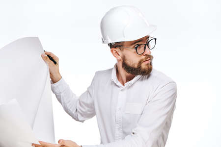 Business man in hard hat, businessman with drawing, man on isolated background. Stock Photo