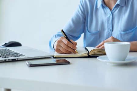 black sweater: Organizer, girl writes in notebook, morning, desktop.