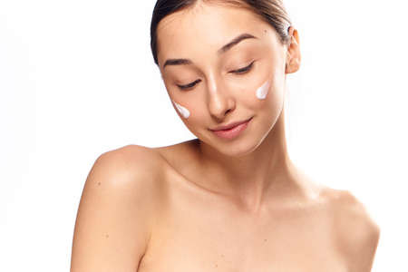 moisturize: Cosmetic face cream, beauty, health, woman on white isolated background, brunette.