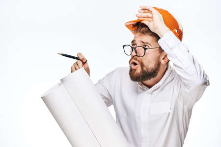 religious clothing: Engineer with a beard on a white isolated background holds a drawing.
