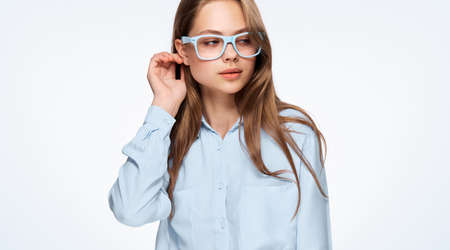 Young beautiful woman in glasses on white isolated background.