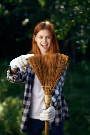 Woman working in the garden, gardener, summer. Stock Photo