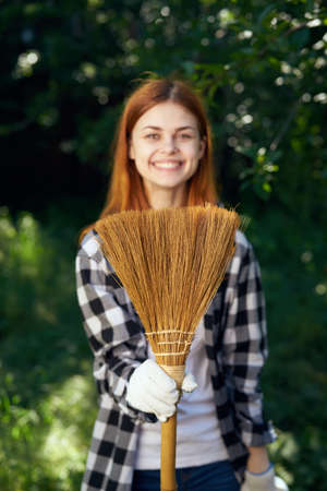 Young woman working in the garden, gardener. Stock Photo