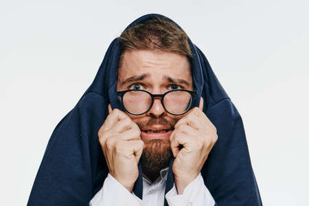 threw: Business man threw a jacket over his head, a businessman in glasses on a light background. Stock Photo