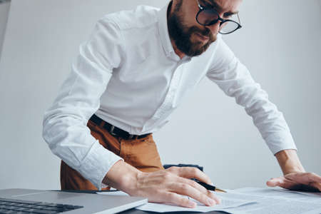 Business man with a beard working at his desk in the office. Stock Photo