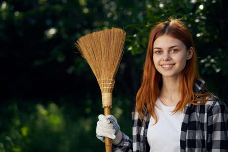 Beautiful young woman running in the garden, gardener. Stock Photo