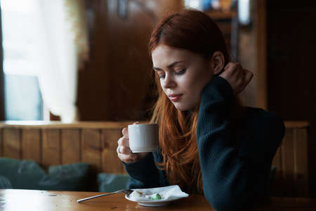 Food, breakfast, coffee, morning, young woman eating at a cafe. Stock Photo