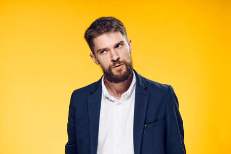 Business man with a beard on a yellow background, portrait. Stock Photo