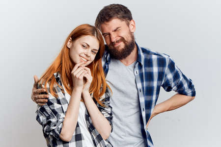 Young guy with beard and beautiful woman on white isolated background, repair, housework. Stock Photo