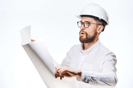 religious clothing: Engineer with beard on white isolated background holds drawings.