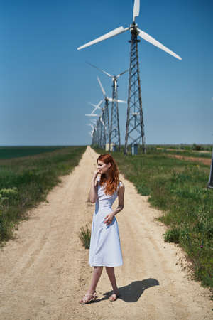 sexualidad: Young beautiful woman in white dress in the field.