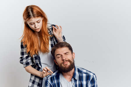 two persons only: Young beautiful woman and guy with a beard on white isolated background, repair, construction tools.