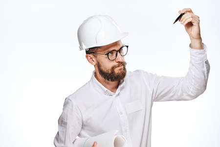 religious clothing: Engineer with a beard on a white isolated background holds a pen and drawing, construction. Stock Photo
